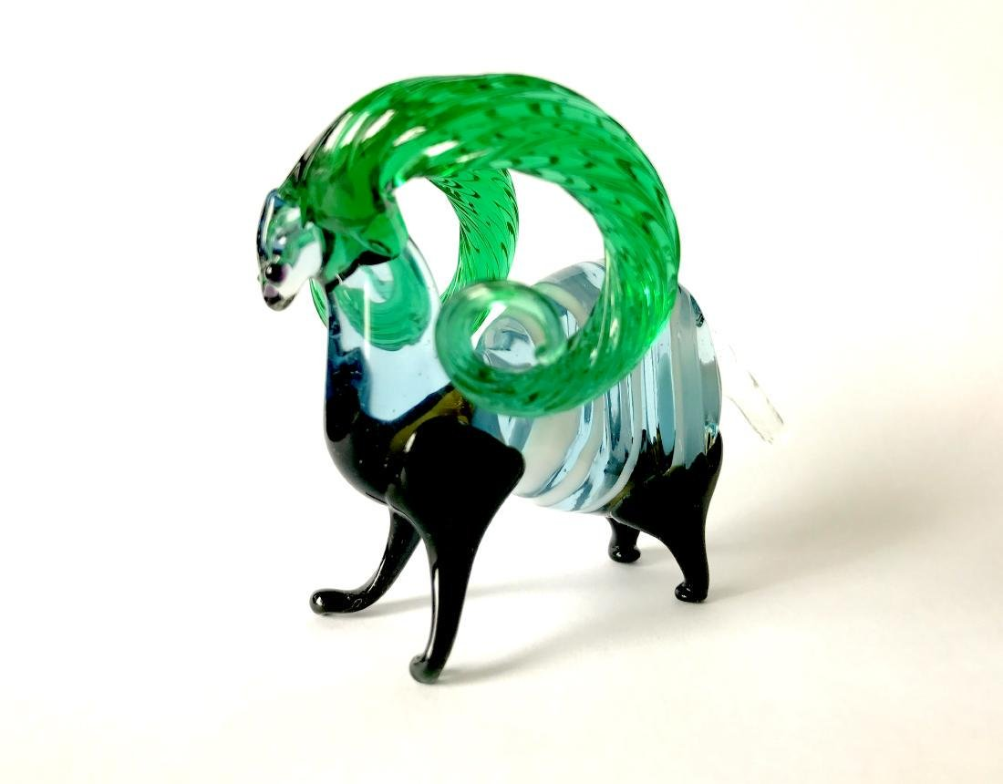 figurine of wether with emerald horns hand blown glass