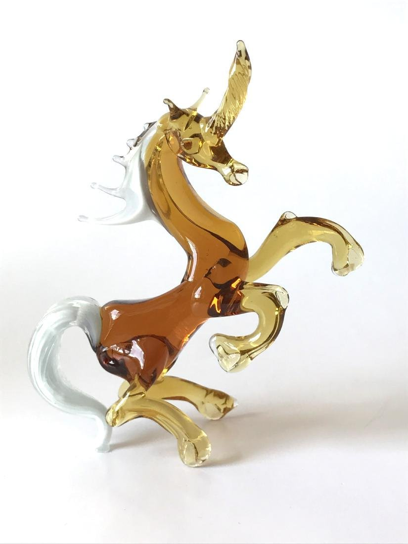 Figurine of unicorn amber coloured hand blown glass
