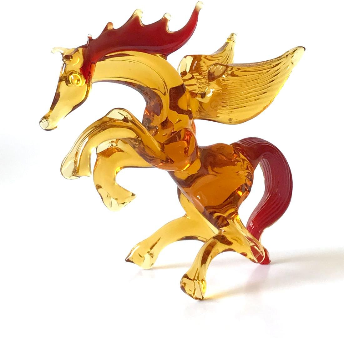 Figurine of Pegasus the winged horse amber coloured