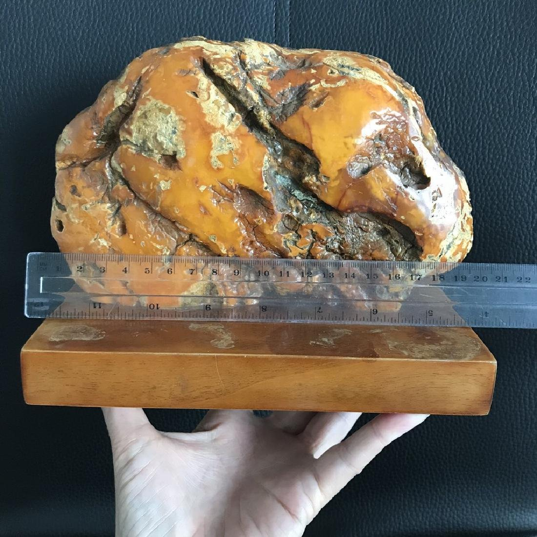 Antique statue Baltic amber rough stone on the wood - 5