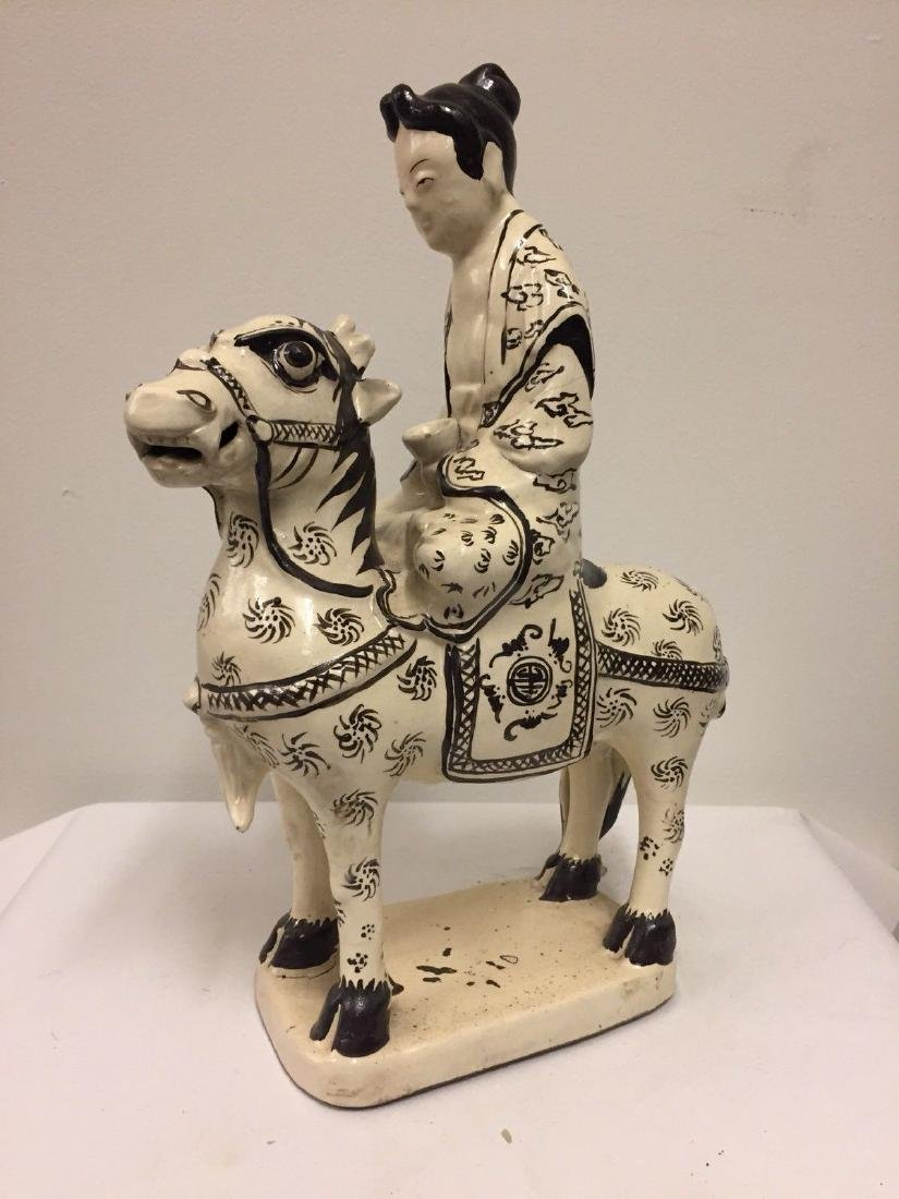 Chinese Black and Cream Glazed Horse and Rider, ca1900