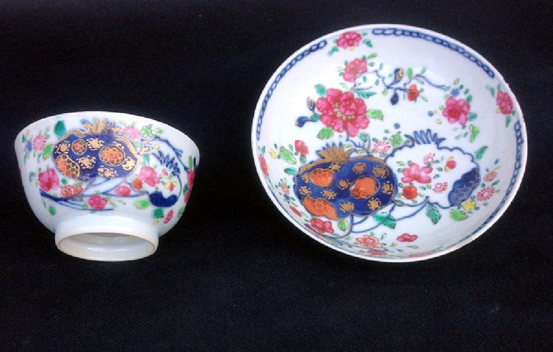 Pomegranate Famille rose cup and saucer, Qianlong