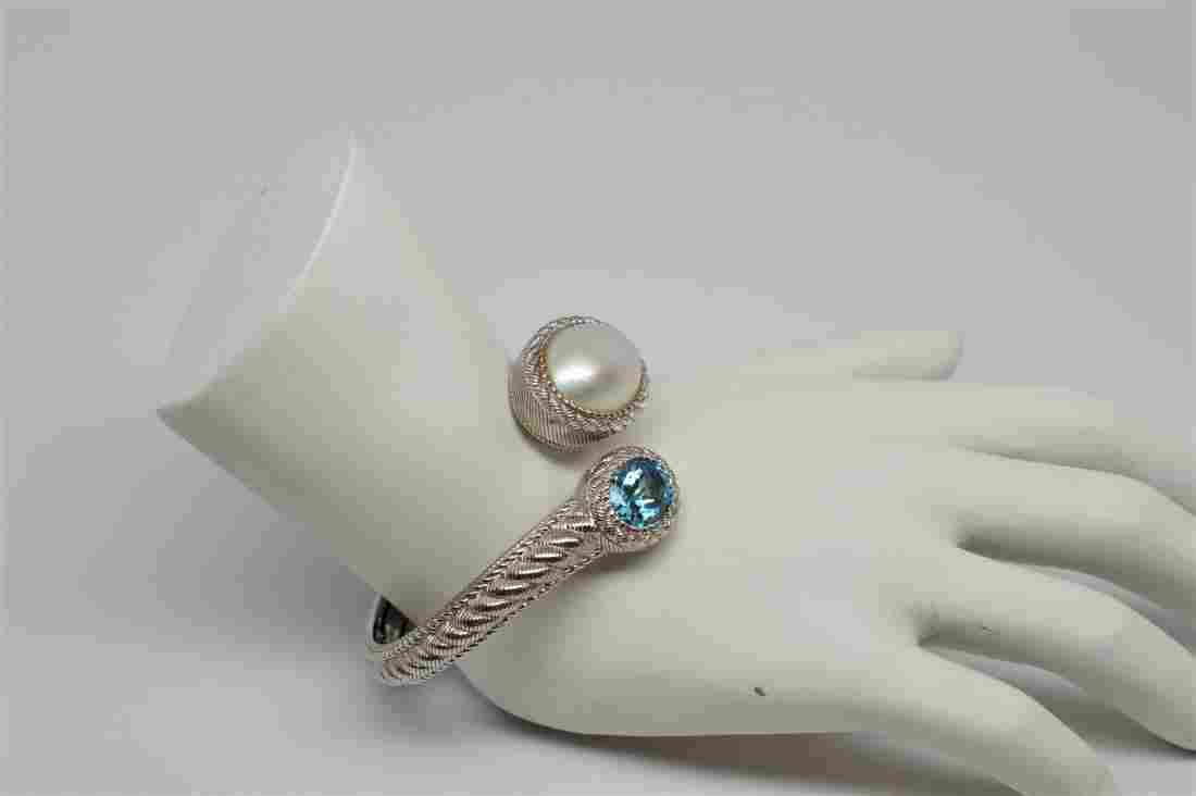 Sterling Silver Hinged Cuff Bracelet with Blue Topaz &
