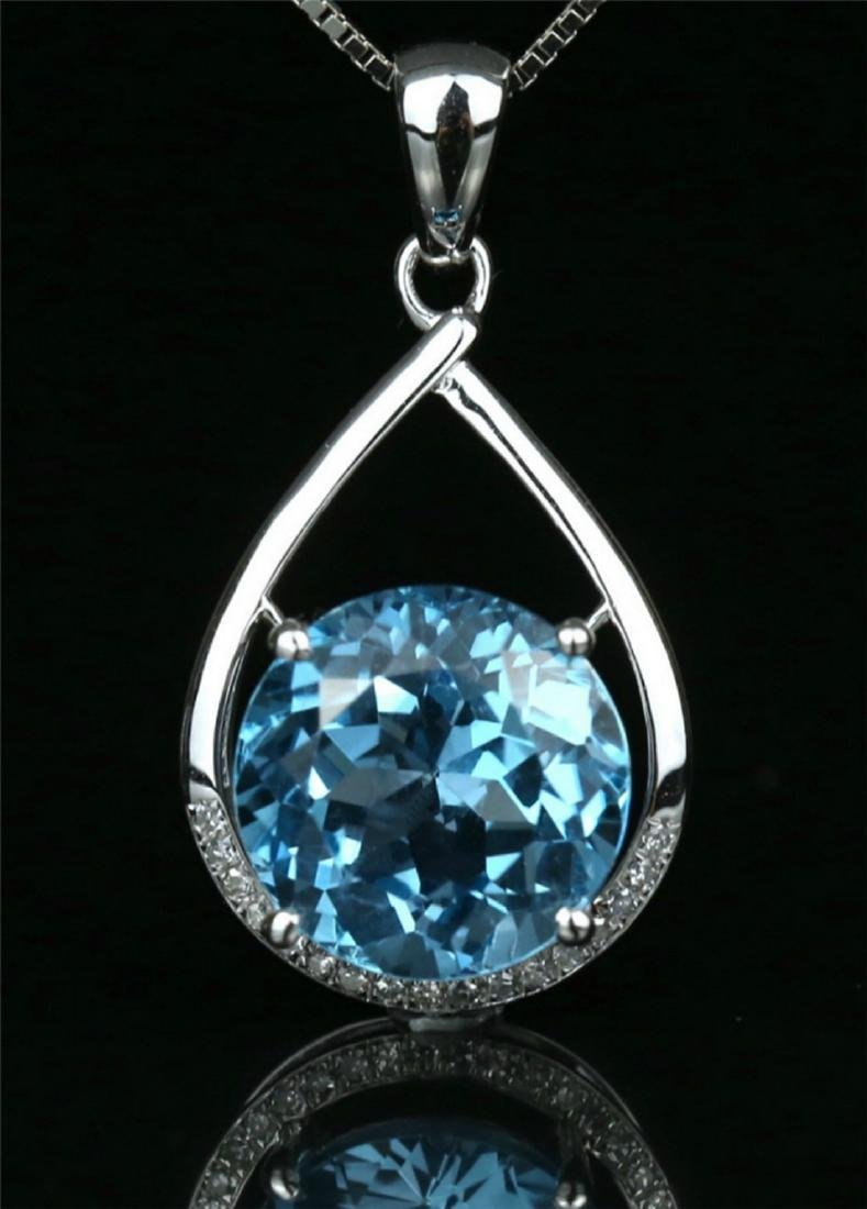 18k white gold pendant with blue topaz 6.7ct. - 2