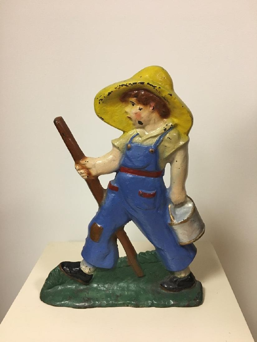 Cast Iron Farmer Boy Door Stop