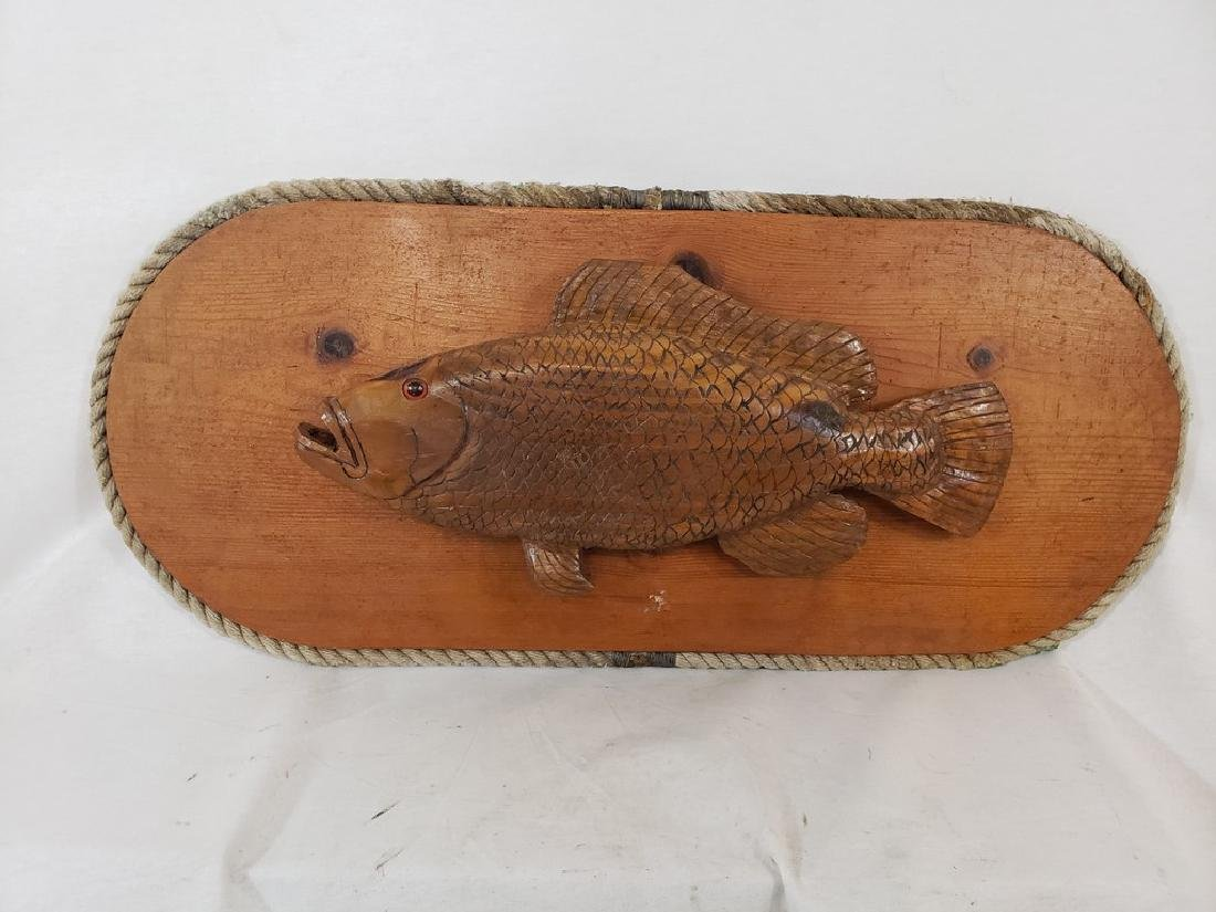 Carved bass plaque with rope trim ca 1940's