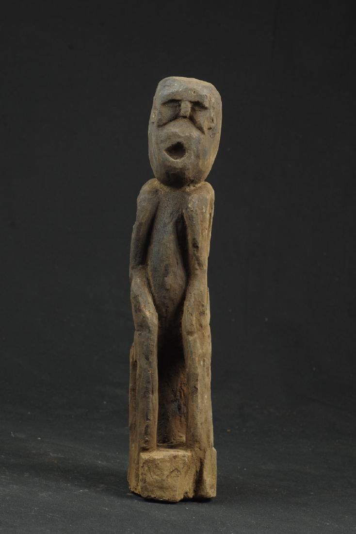 Sitting ancestor figure expressive face