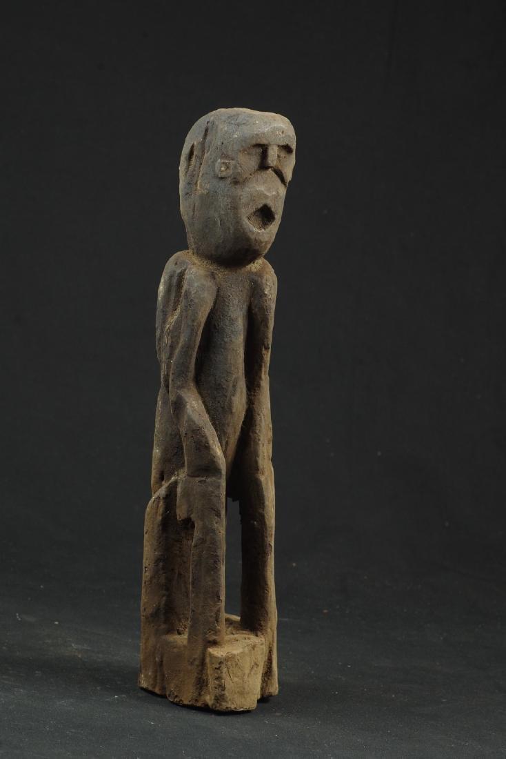 Sitting ancestor figure expressive face - 2
