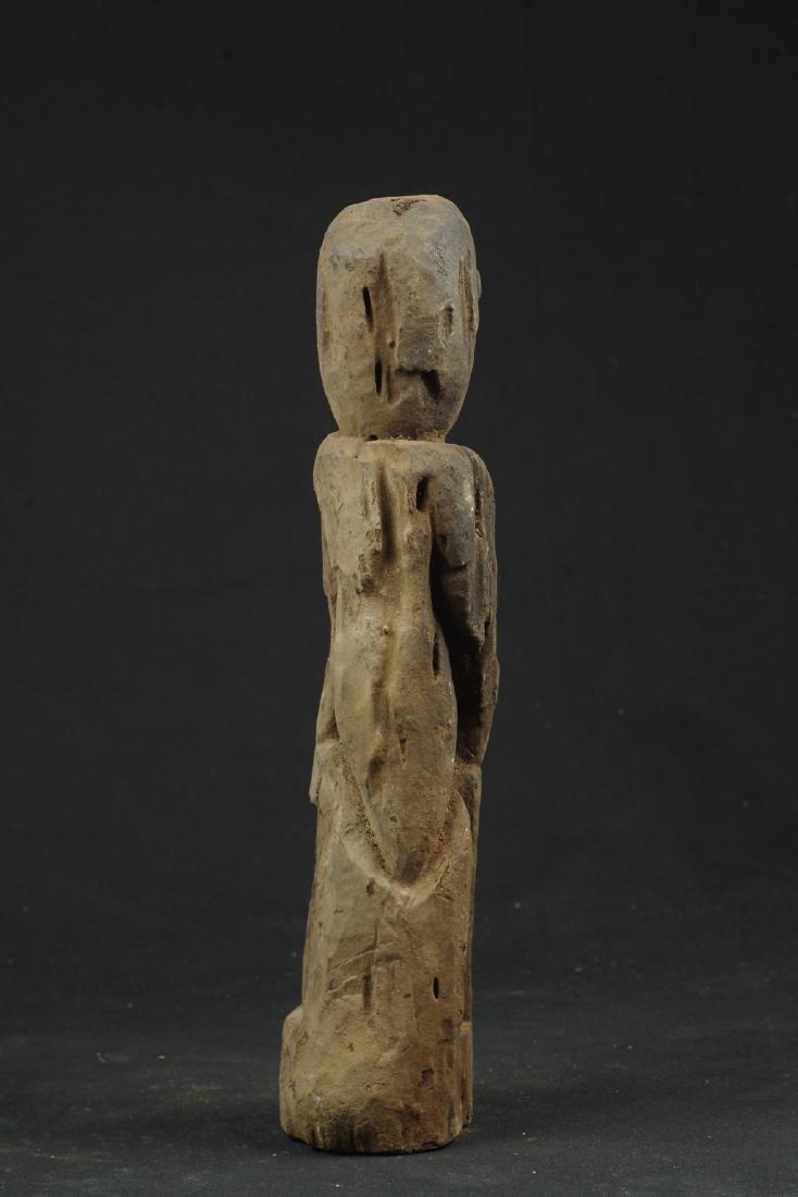 Sitting ancestor figure expressive face - 5
