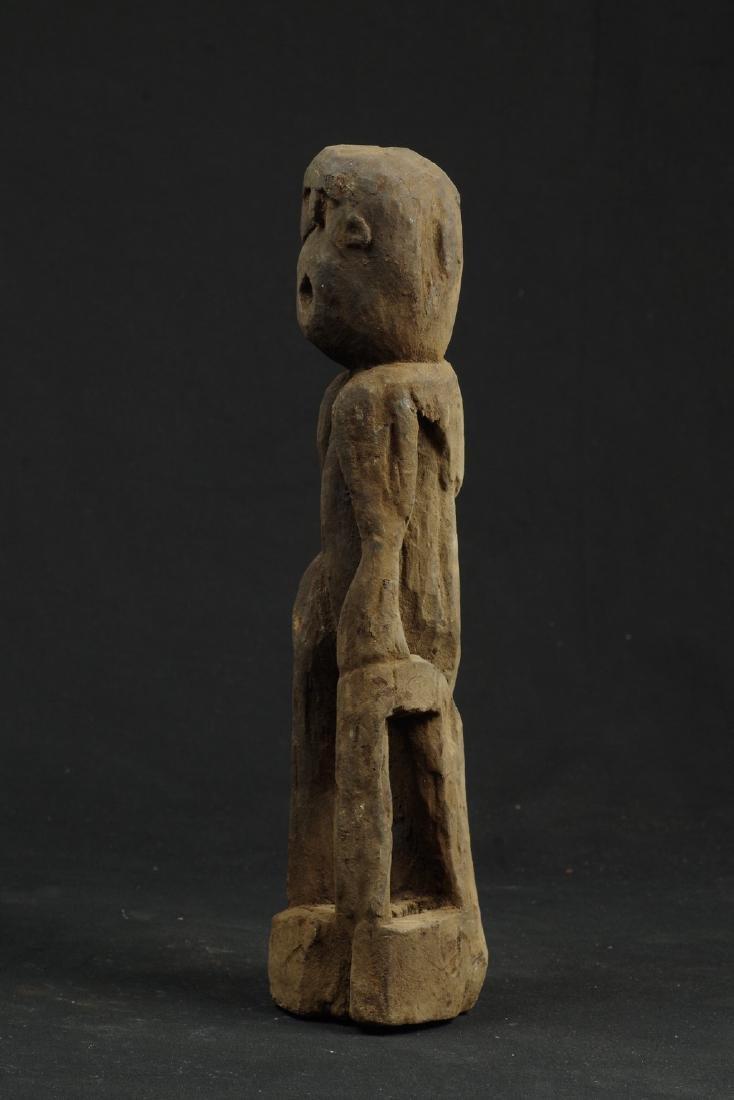 Sitting ancestor figure expressive face - 6