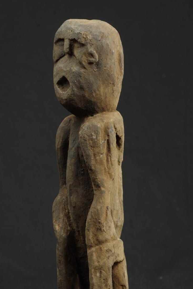 Sitting ancestor figure expressive face - 8