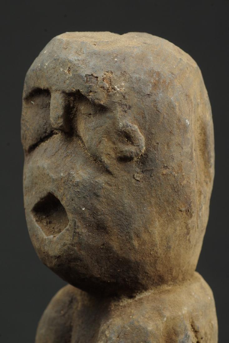 Sitting ancestor figure expressive face - 9