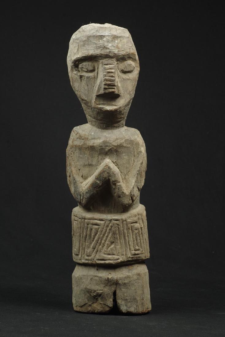 Old massive ancestor figure