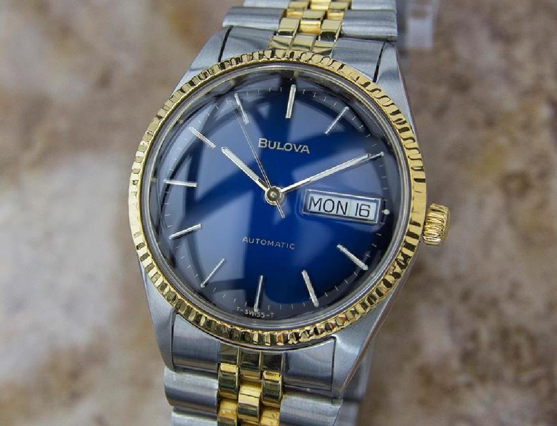 Bulova Swiss Made 1980s Day Date Mens Gold Plate and
