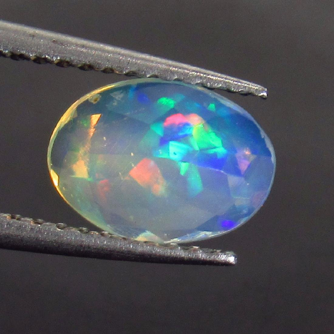 0.80 Ct Genuine Ethiopian Multi-Color Fire Faceted Opal - 2
