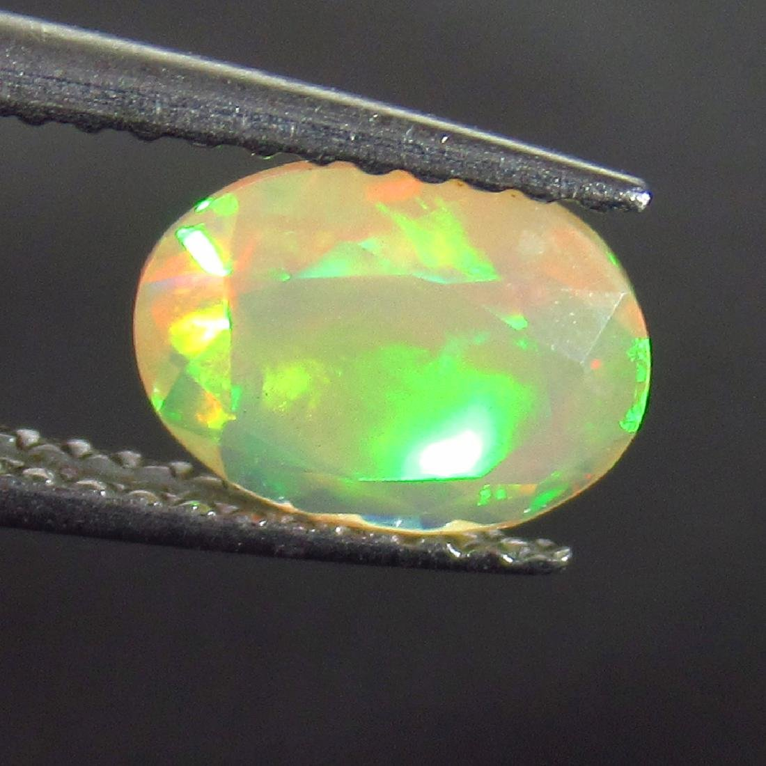 0.73 Ct Genuine Ethiopian Honey Fire Faceted Opal Oval