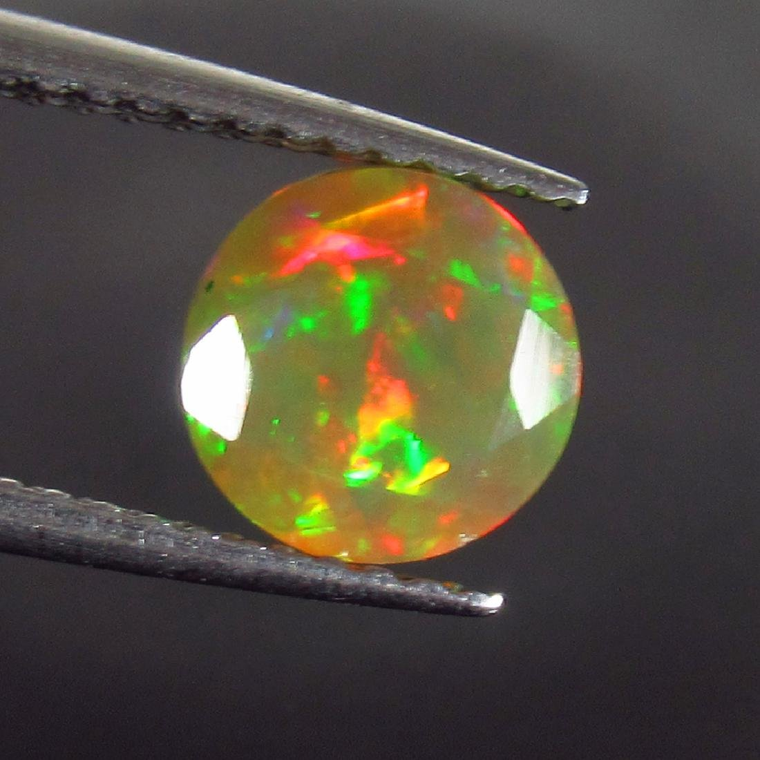 0.81 Ct Genuine Ethiopian Honey Fire Faceted Opal 6.8