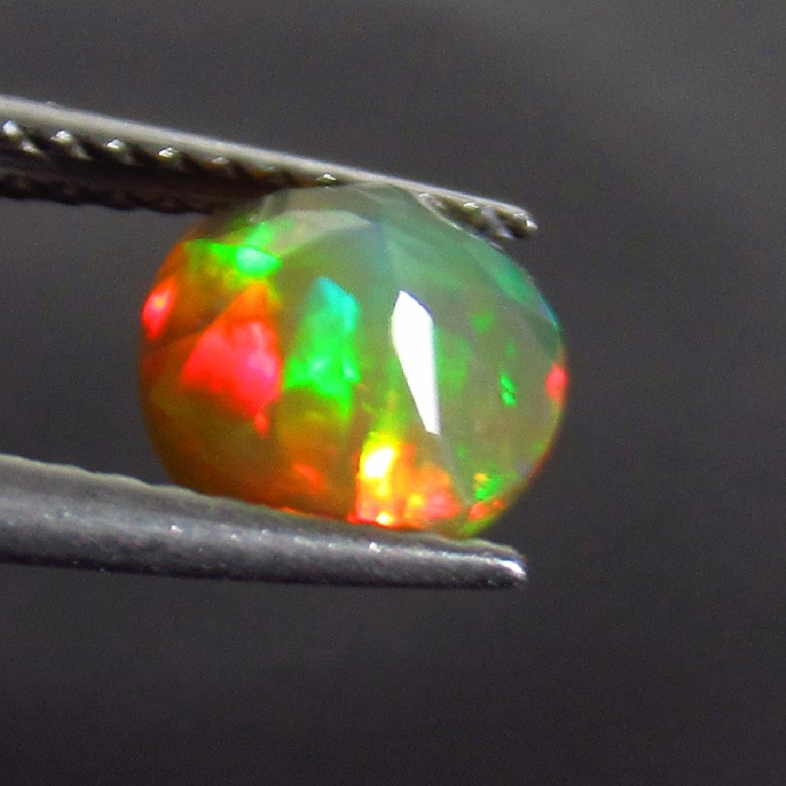 0.81 Ct Genuine Ethiopian Honey Fire Faceted Opal 6.8 - 2
