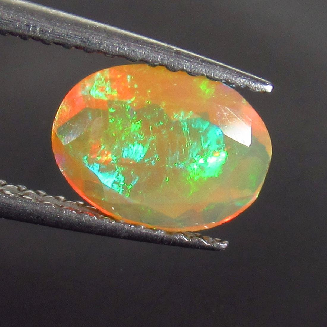 0.98 Ct Genuine Ethiopian Honey Fire Faceted Opal 9X7