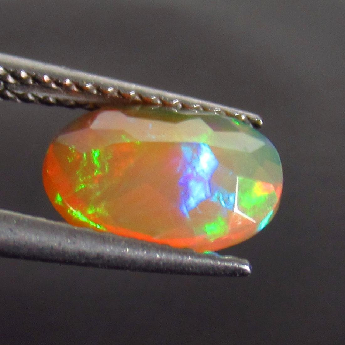 0.98 Ct Genuine Ethiopian Honey Fire Faceted Opal 9X7 - 2