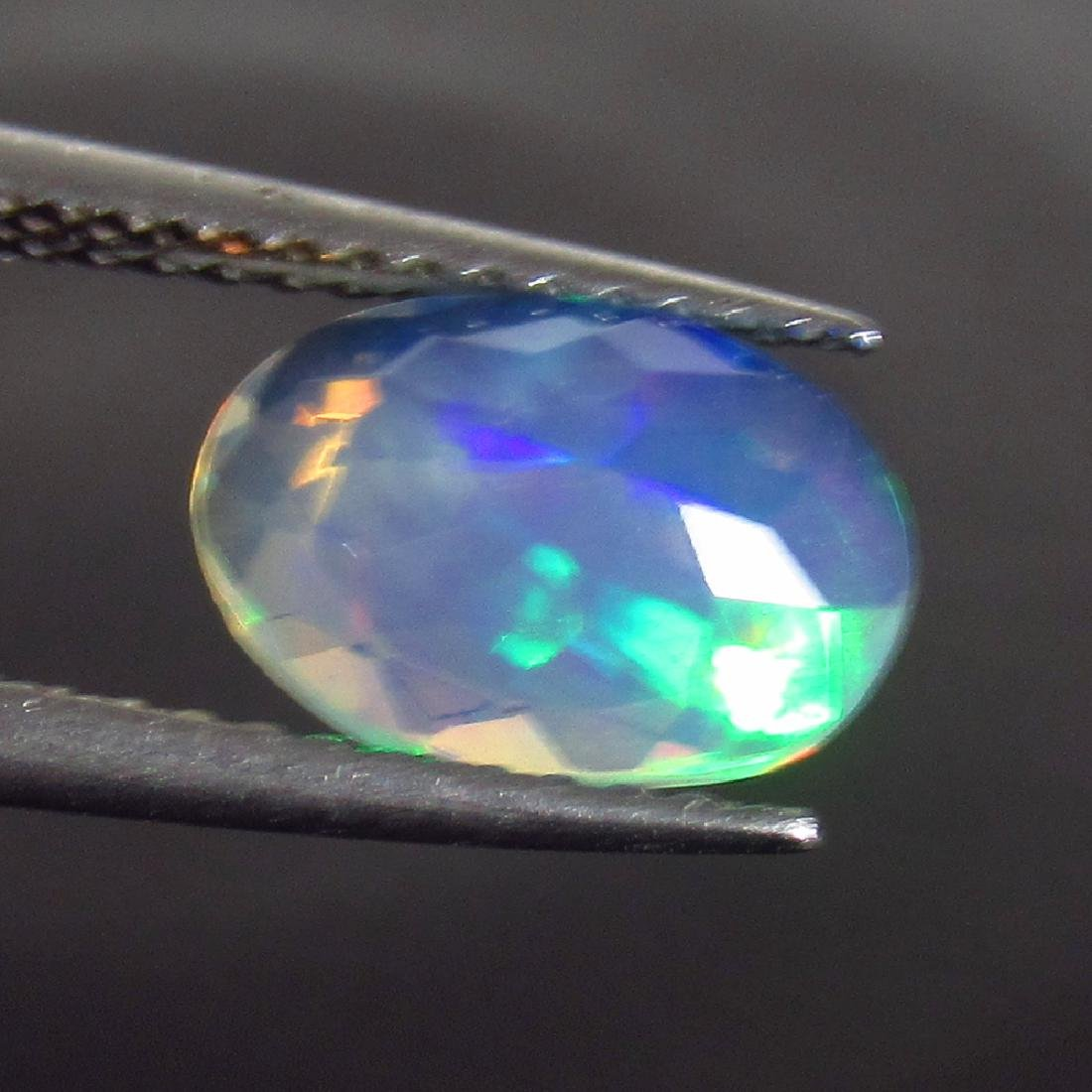 0.93 Ct Genuine Ethiopian Multi-Color Fire Faceted Opal - 2