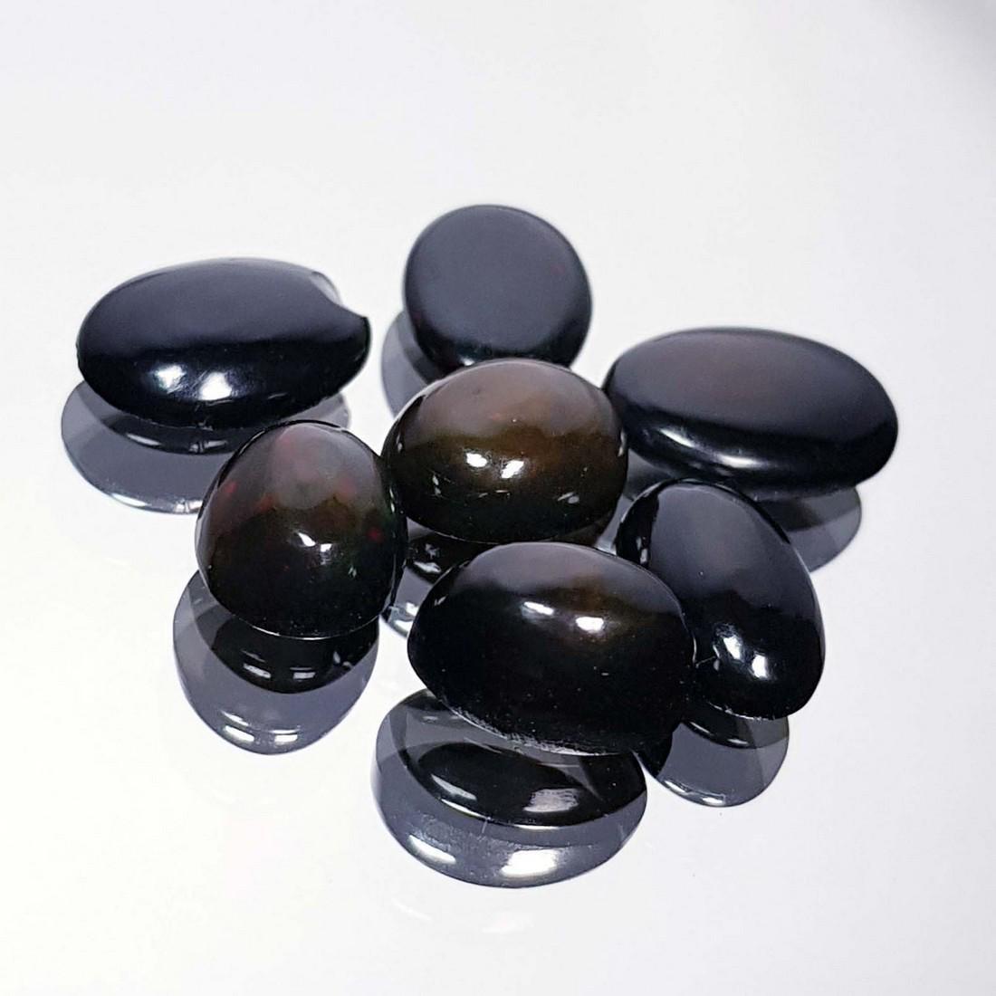 7 Pcs Of Black Opal - 7.24 ct
