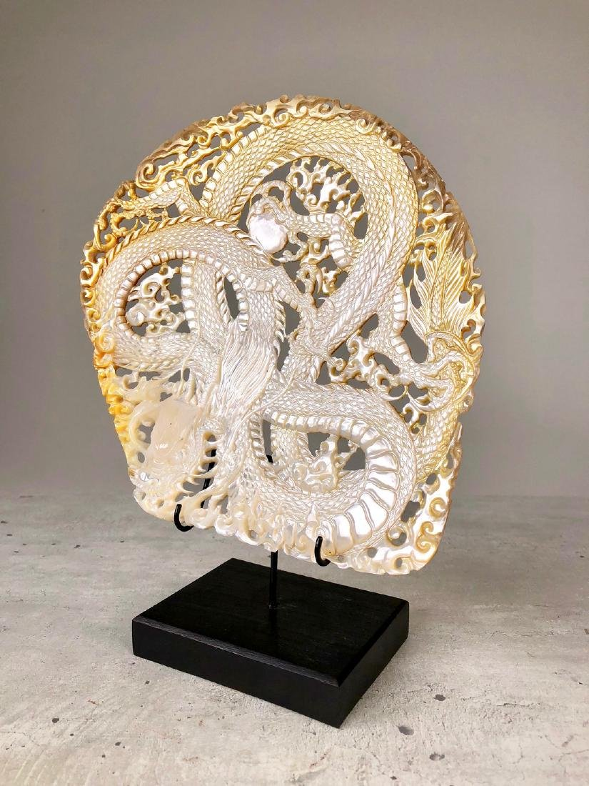 Intricately carved Mother of Pearl Shell with Dragon