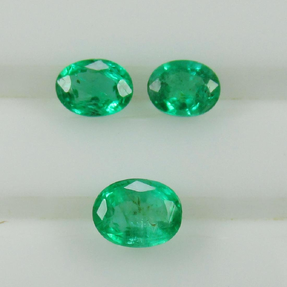 0.68 Ct Genuine Zambian Emerald Matching Oval Set