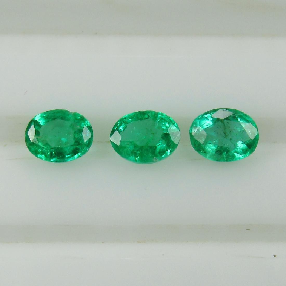 0.70 Ct Genuine Zambian Emerald Matching Oval Set