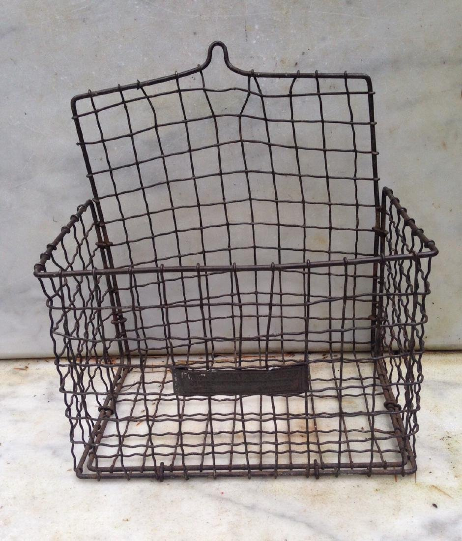 C 1900 wire basket with label