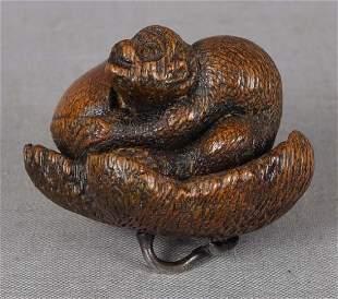 19c netsuke MONKEY with chestnut on tangerine silver