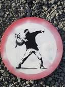 Banksy Flower Thrower spray paint on metal road sign