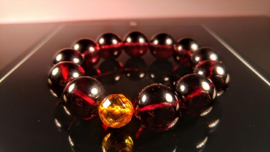 Round beads Baltic amber bracelet Cherry colour with