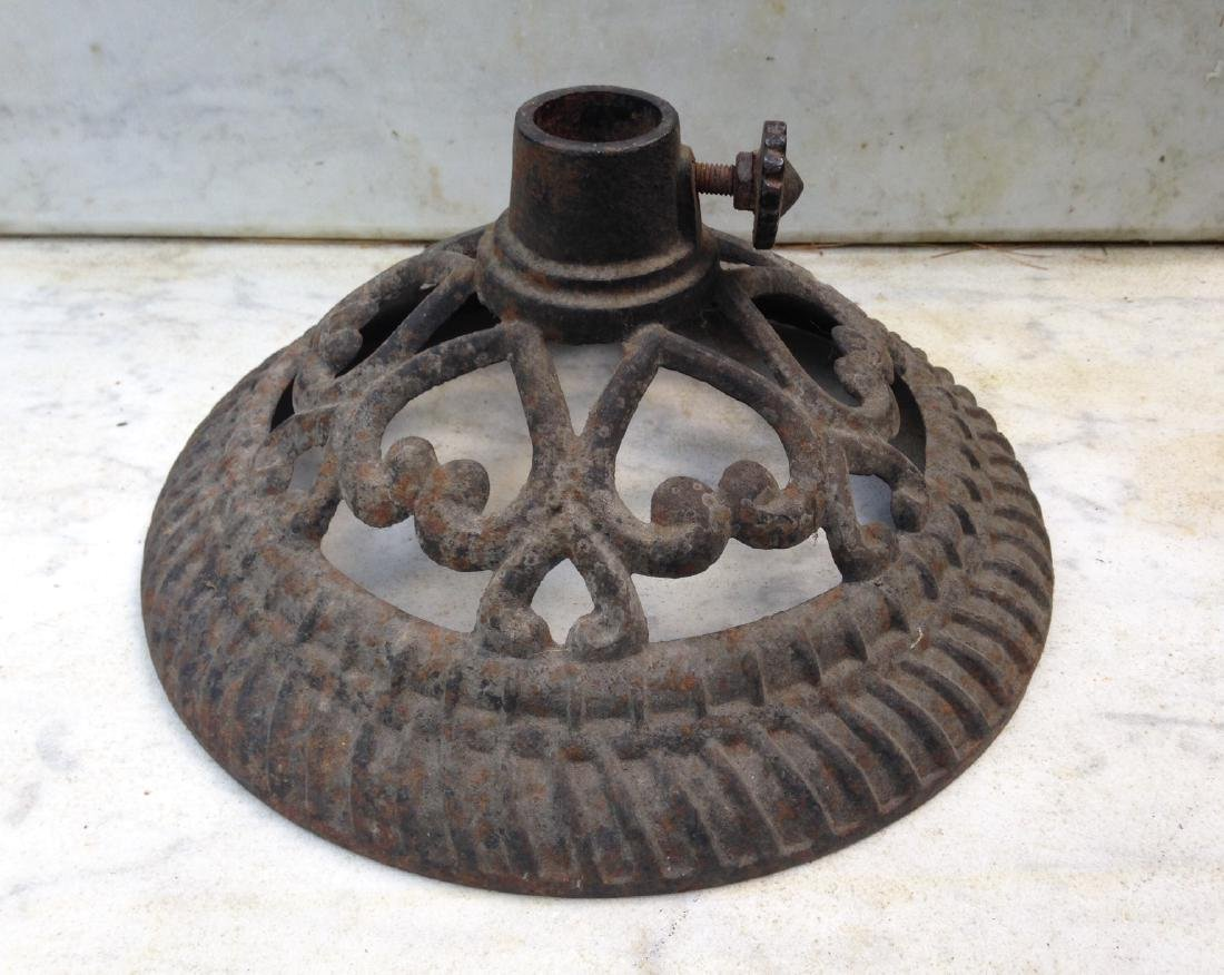 Late 19thc cast iron flag stand with hearts