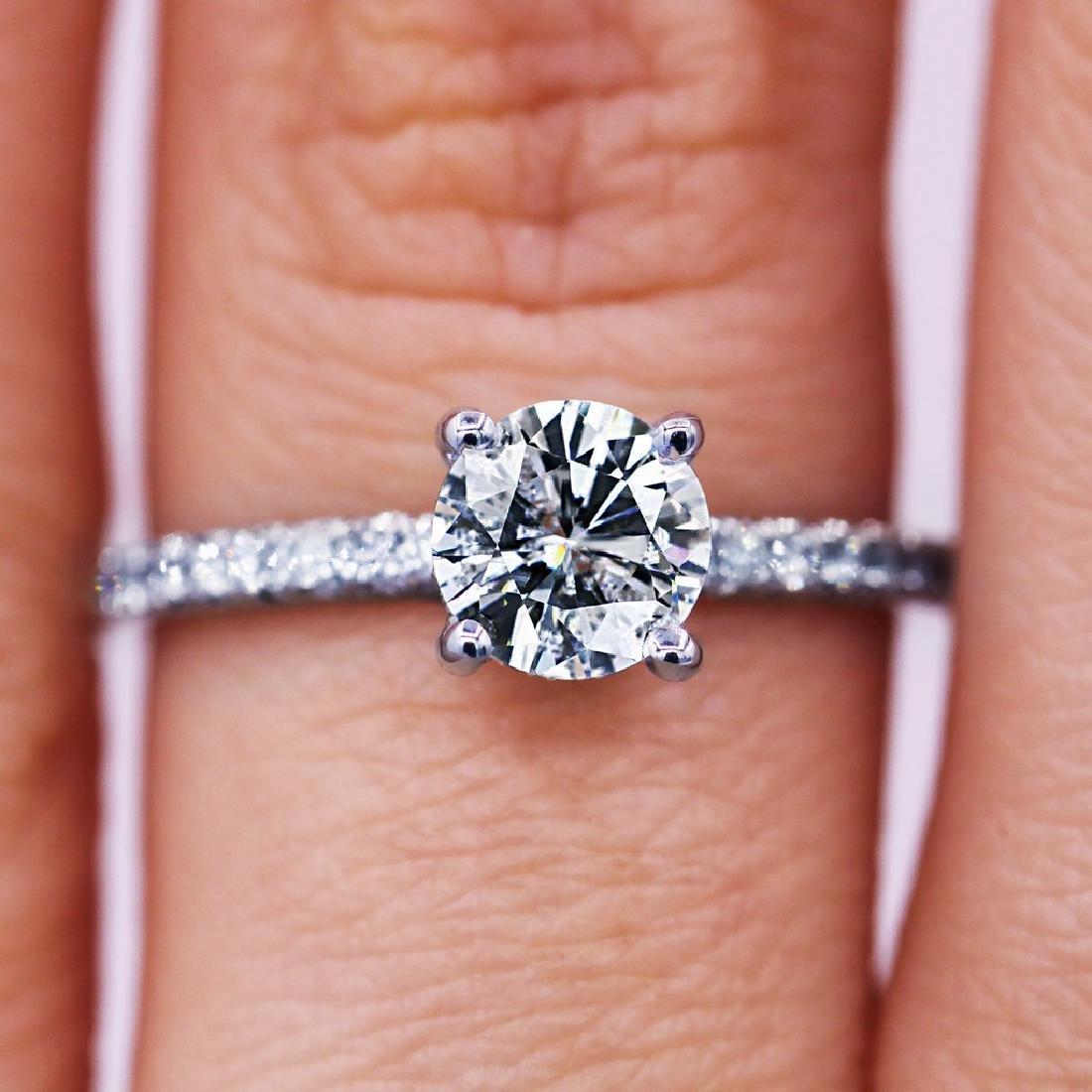 Sparkling 1.03 TCW round cut diamond pave engagement