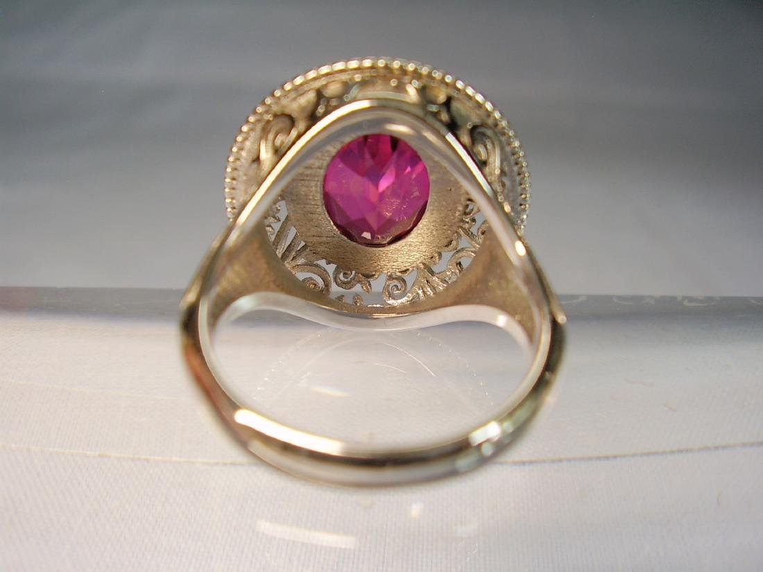 Ring with red Topaze faceted - 7