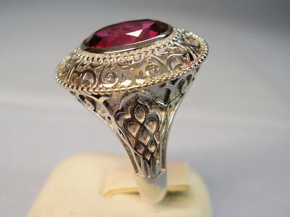 Ring with red Topaze faceted - 8
