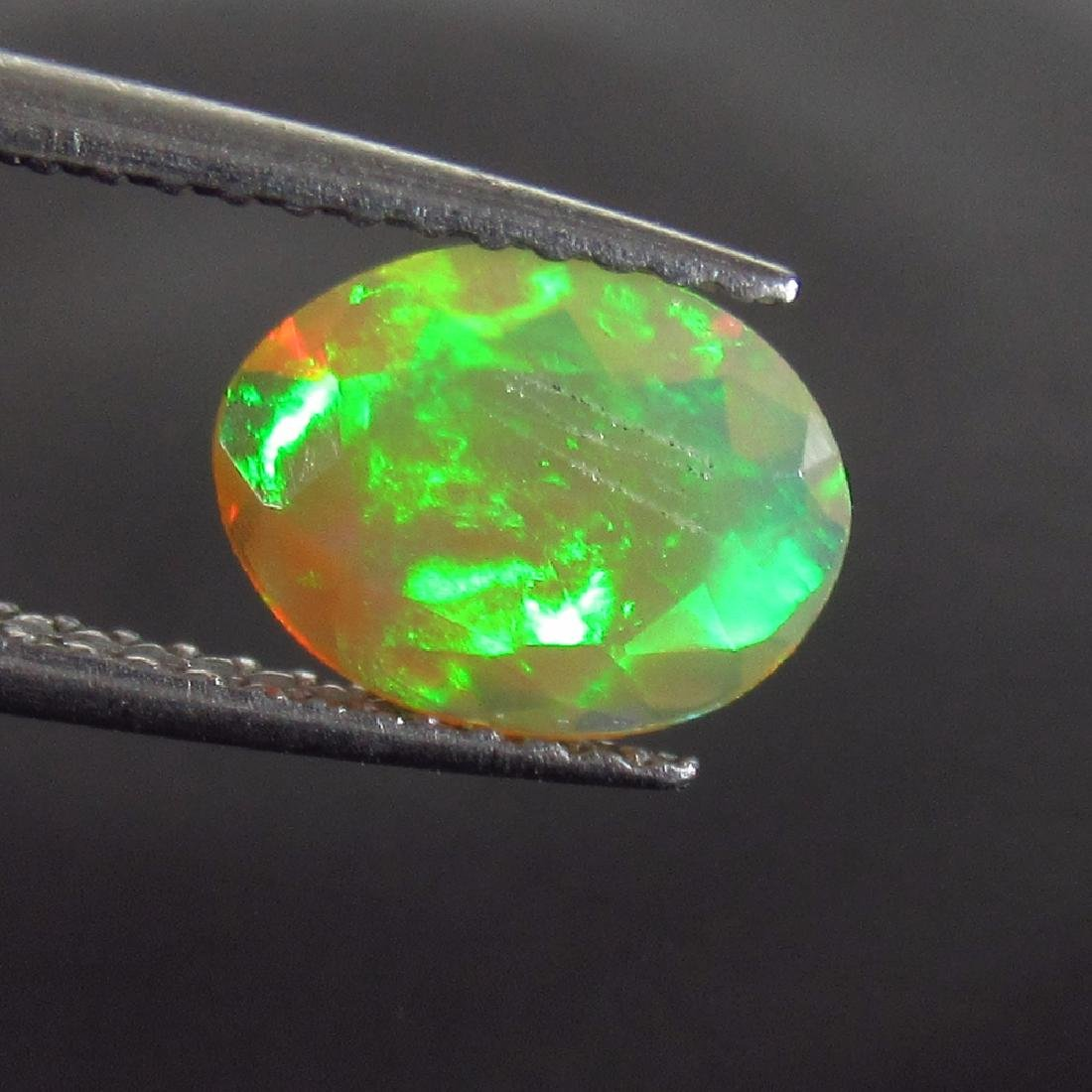 0.70 Ctw Natural Ethiopian Honey Fire Faceted Opal Oval
