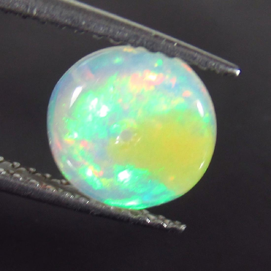1.21 Ctw Natural Drilled Multi-Color Fire 8 mm Round