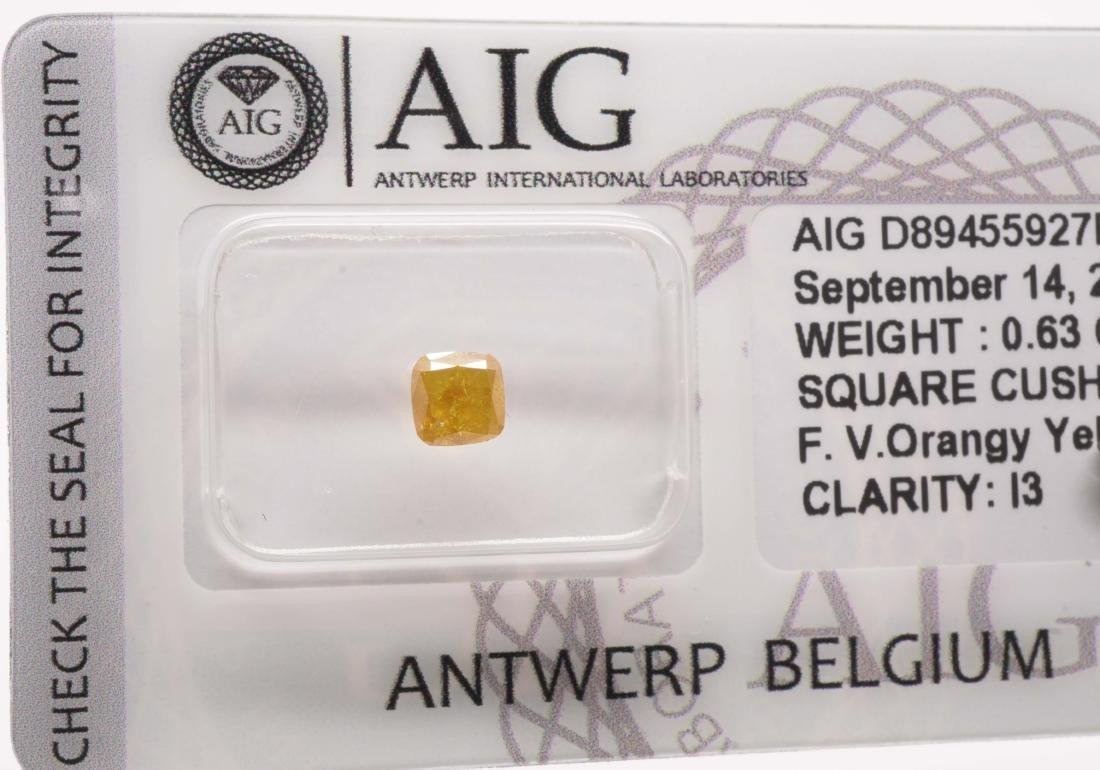 0.63 CTS Certified Natural Fancy Vivid Orangy Yellow