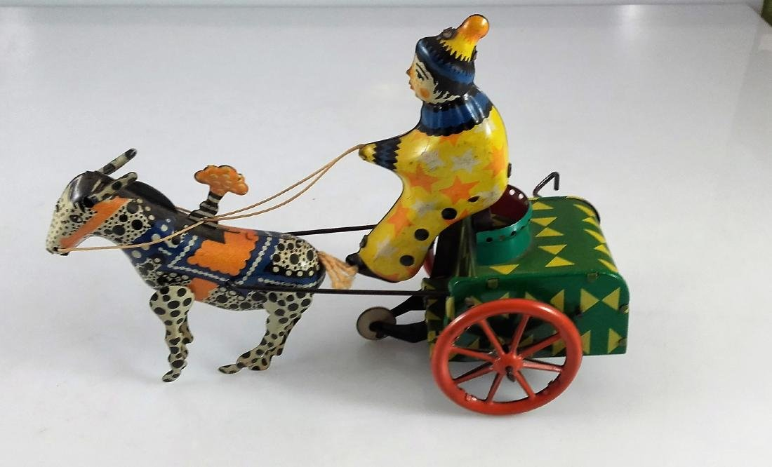 WIND UP CLOWN ON CART WITH DONKEY