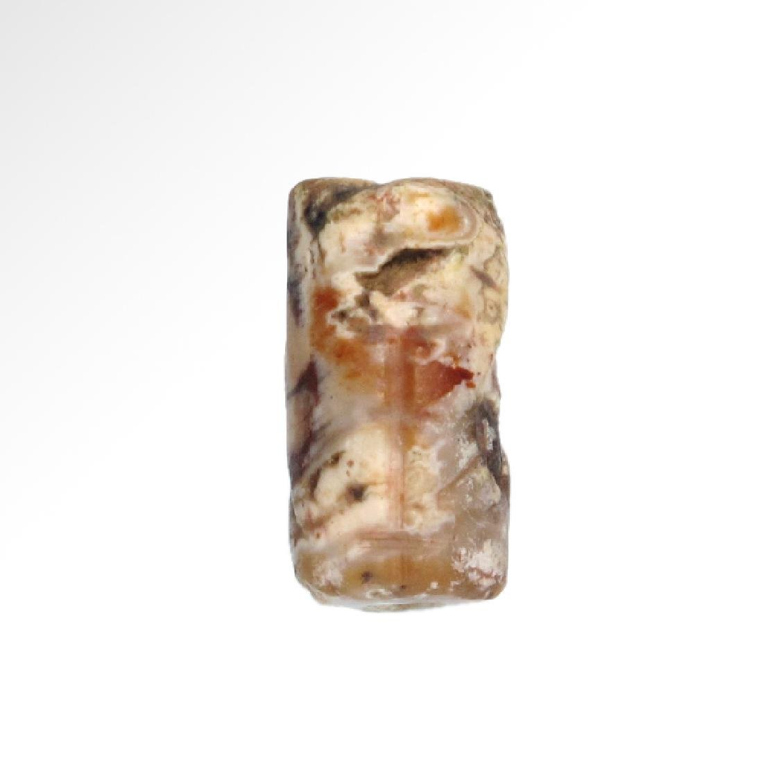Neo-Babylonian Agate Cylinder Seal with 'Bird-Man',  c. - 3