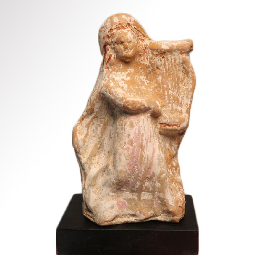 Canosan Painted Terracotta Figure of a Musician with - 7