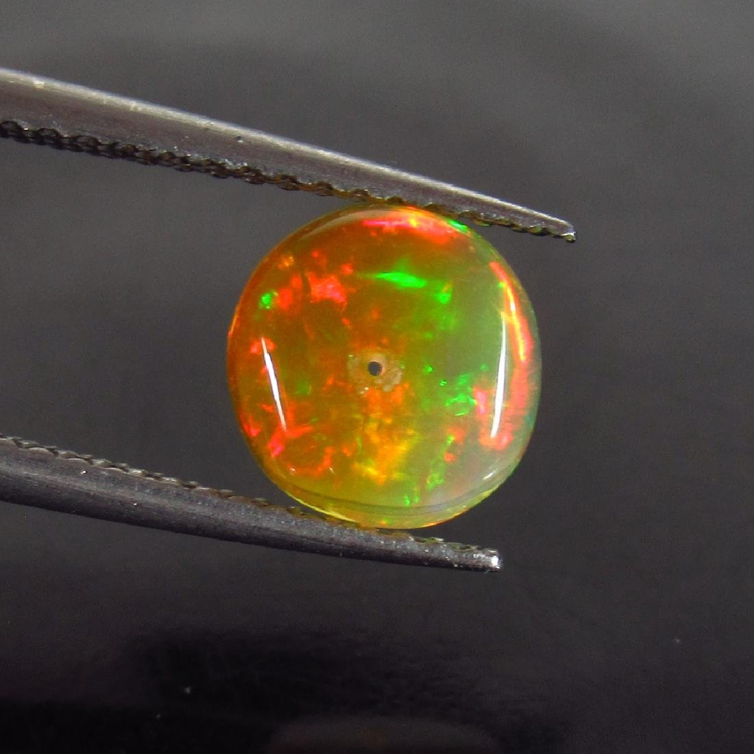 1.21 Ctw Natural Drilled Multi-Color Fire 8.2 mm Round