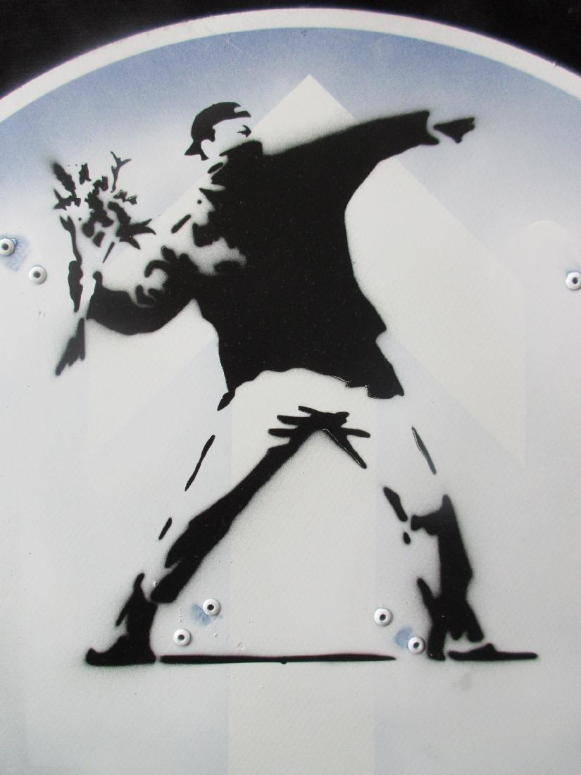 Banksy Flower Thrower spray paint road works sign. - 2