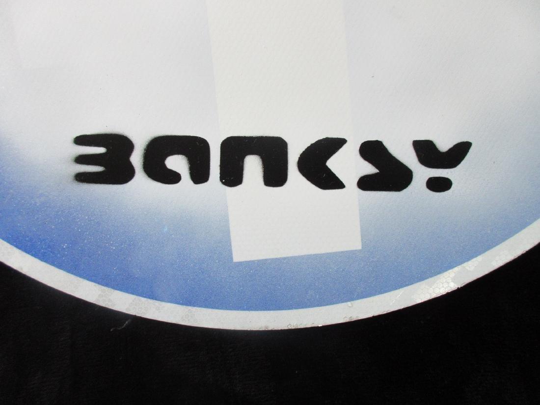 Banksy Flower Thrower spray paint road works sign. - 3