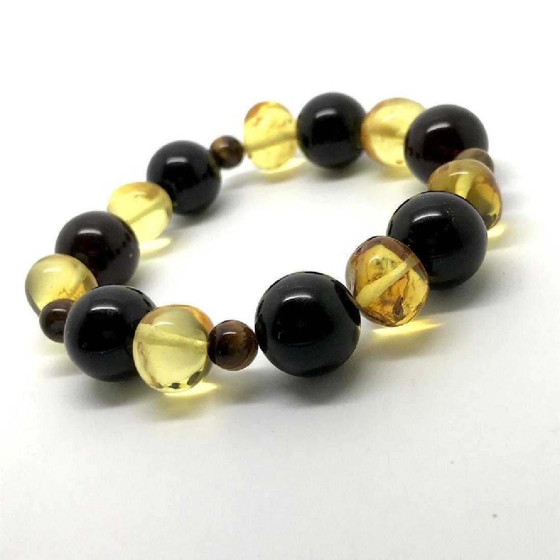 Bracelet Baltic amber with fly inclusion &Tiger eye