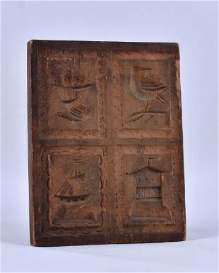 Beautifully carved cookie board with four well carved