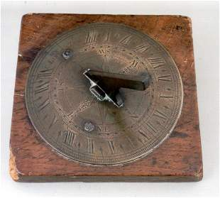 A George III brass sundial by Charles Lincoln