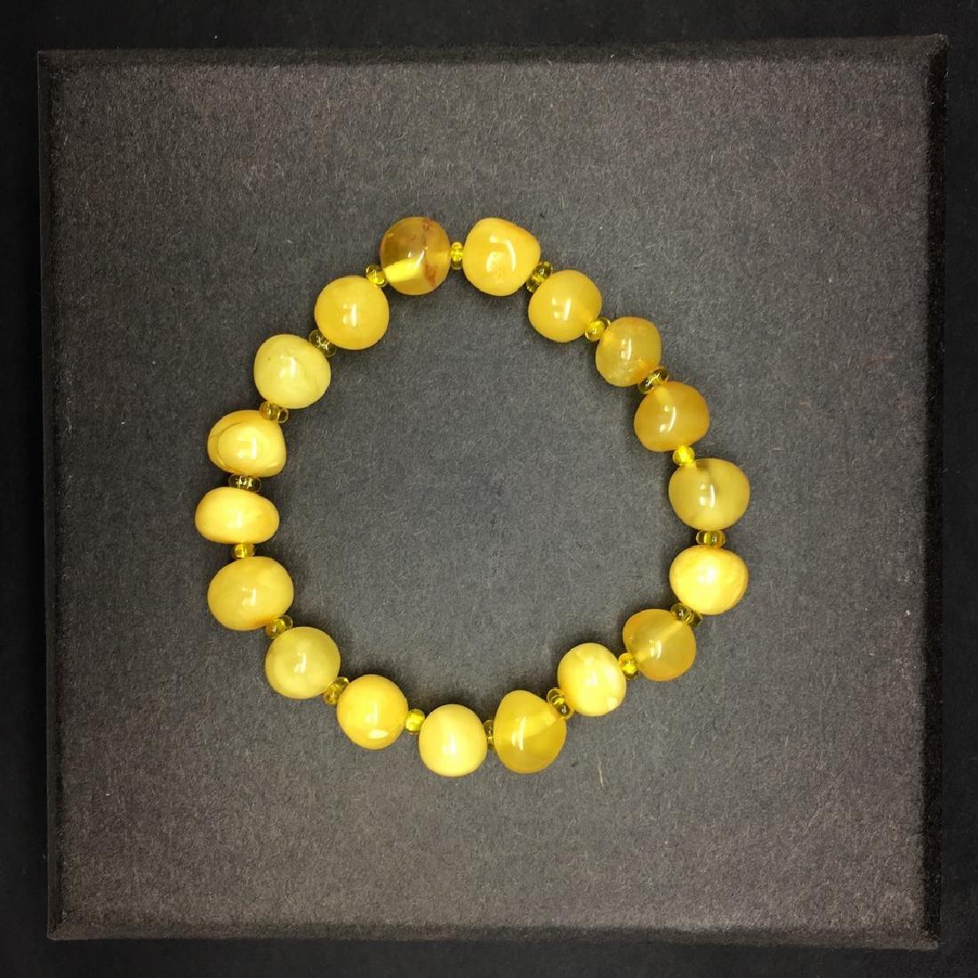 Bracelet amber  baroque hand-polished beads 8,6g - 3